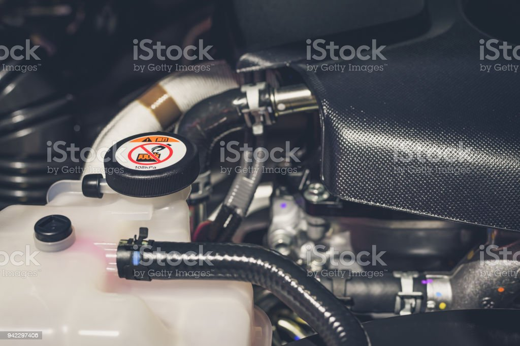 Coolant tank and warning information in engine room stock photo
