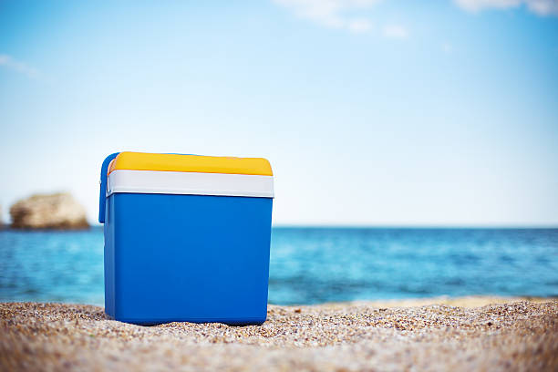 Cooler box on the beach Blue cooler box on the beach cooler container stock pictures, royalty-free photos & images