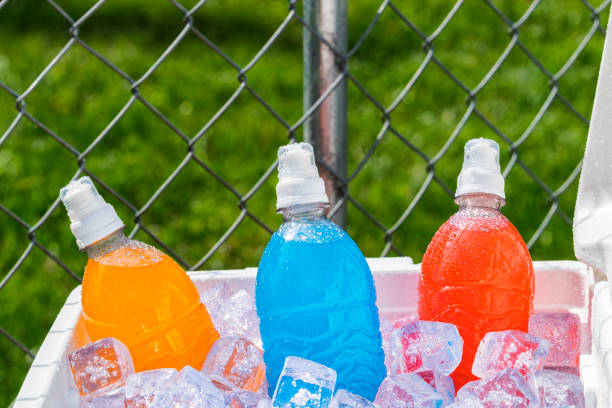 Cooler full of Ice cold colorful sports drinks stock photo