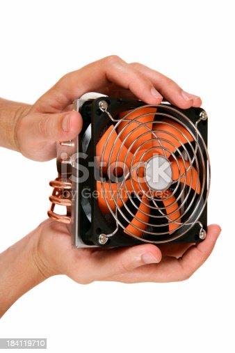 466623283 istock photo CPU cooler in hands 184119710