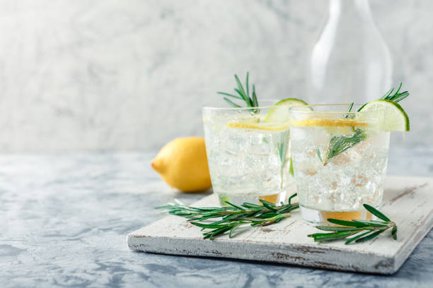 Cooling alcoholic or non-alcoholic cocktail with lemon stock photo