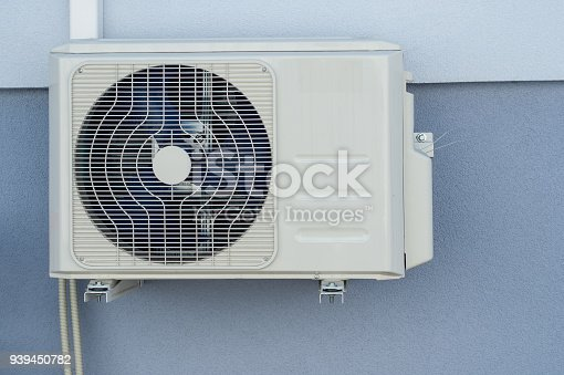 939450782istockphoto Cooling Fan Air Conditioner on wall background 939450782