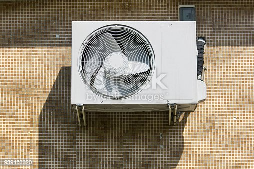 939450782istockphoto Cooling Fan Air Conditioner on wall background 939453320