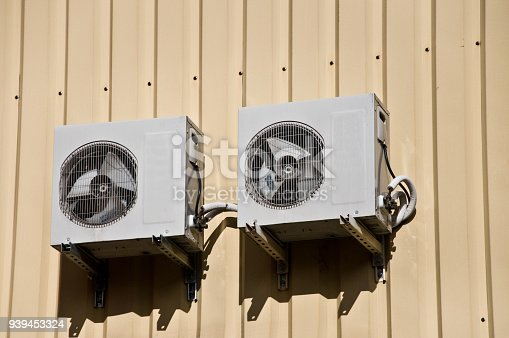 939450782istockphoto Cooling Fan Air Conditioner on wall background 939453324