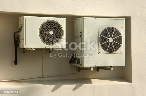 939450782istockphoto Cooling Fan Air Conditioner on wall background 939453714
