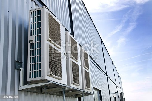939450782istockphoto Cooling Fan Air Conditioner on wall background 939453882
