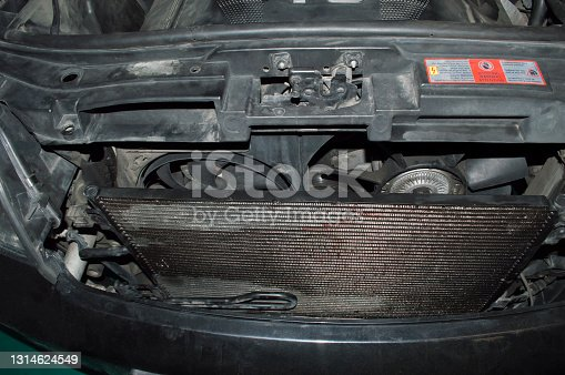 The radiator and two fans of the engine cooling system are installed on the car