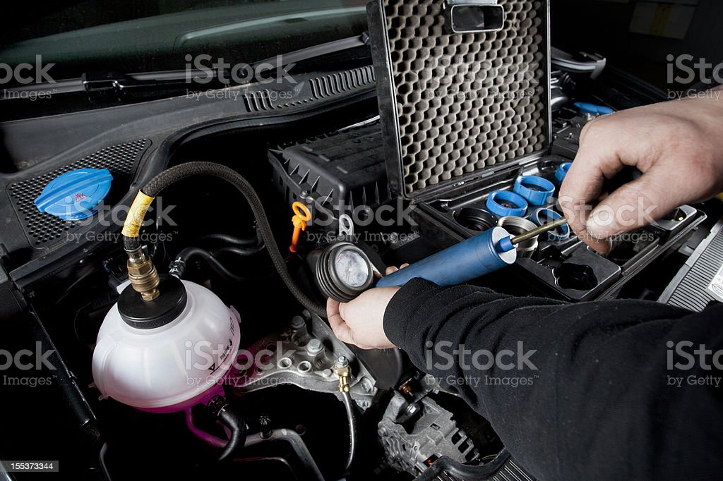 Cooling system of a modern car, leak test royalty-free stock photo