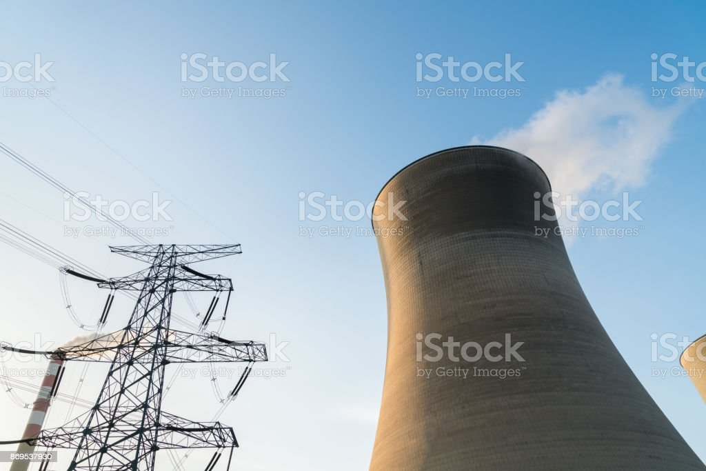 cooling tower at dusk stock photo