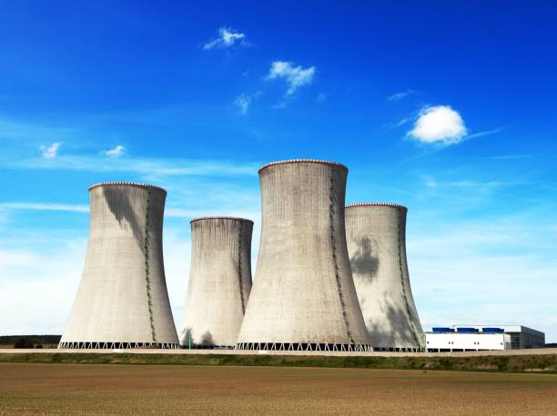 Cooling tower with clouds, nuclear power plant Cooling tower with clouds, nuclear power plant Dukovanz, Cyech Republic nuclear power station stock pictures, royalty-free photos & images