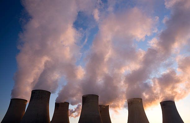 Cooling towers at a coal fueled power station. stock photo