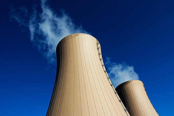 Cooling towers of nuclear power plant against  blue sky Cooling towers of nuclear power plant against the blue sky nuclear power station stock pictures, royalty-free photos & images