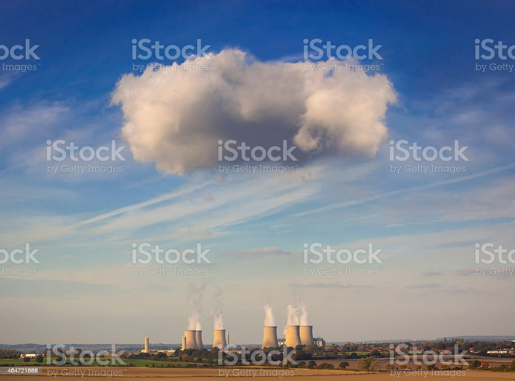 Cooling towers spew clouds into the atmosphere stock photo