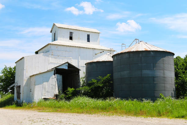 co-op agricultural feed grain and corn silo farm storage building against a blue sky in rural heartland america perfect for industry farming and commercial agriculture marketing stock photo