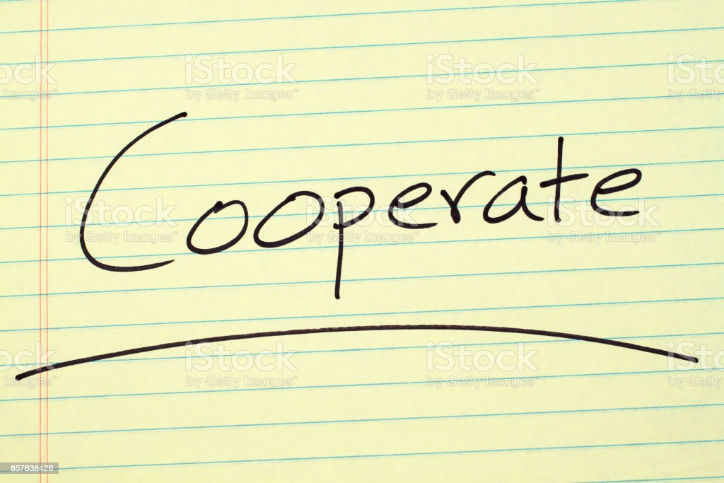 Cooperate On A Yellow Legal Pad stock photo
