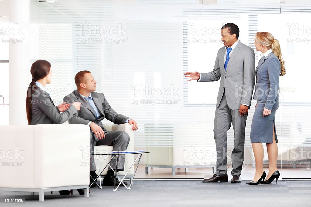 Cooperation between different people, communicate at the workplace. royalty-free stock photo