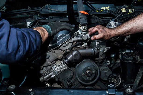 cooperation on repairing motors two hands holding a car engine diesel stock pictures, royalty-free photos & images