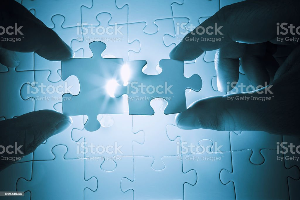 Cooperation to solve a puzzle stock photo