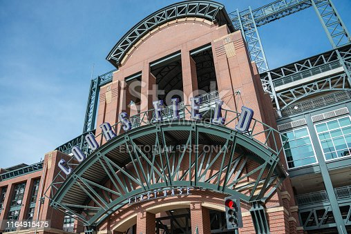 Streetside view of Coors Field, home to the MLB Colorado Rockies and named after the brewing company from Golden, Colorado.