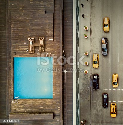 istock Coouple on a New York City rooftop. Image composition. 694408864
