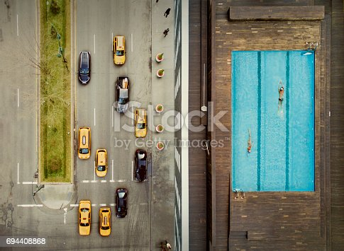 istock Coouple on a New York City rooftop. Image composition. 694408868