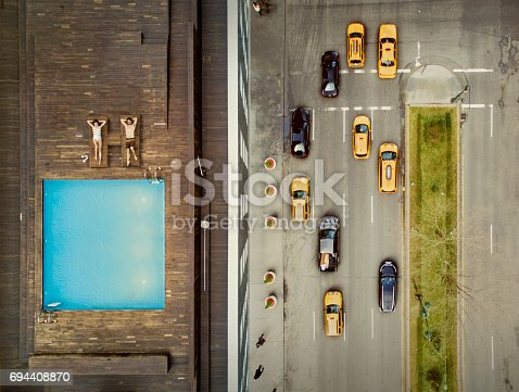 istock Coouple on a New York City rooftop. Image composition. 694408870
