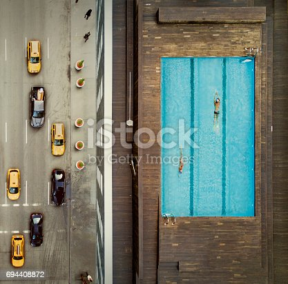 istock Coouple on a New York City rooftop. Image composition. 694408872