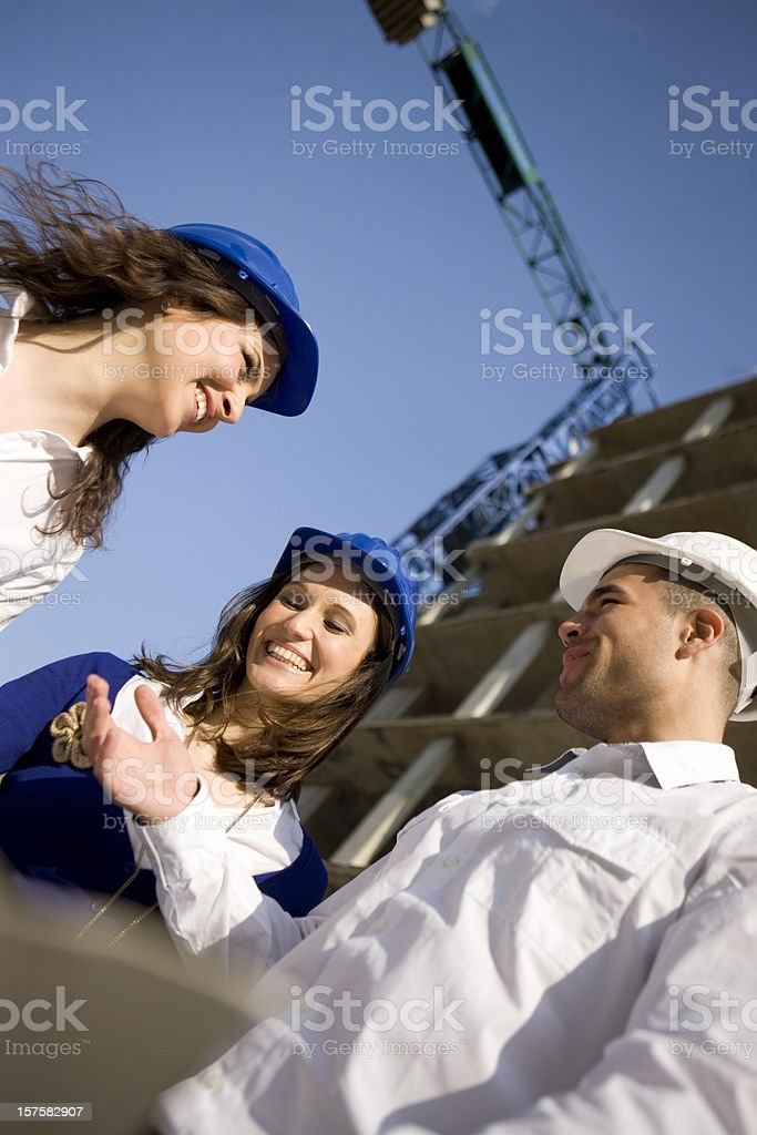 Cooworkers on construction site royalty-free stock photo