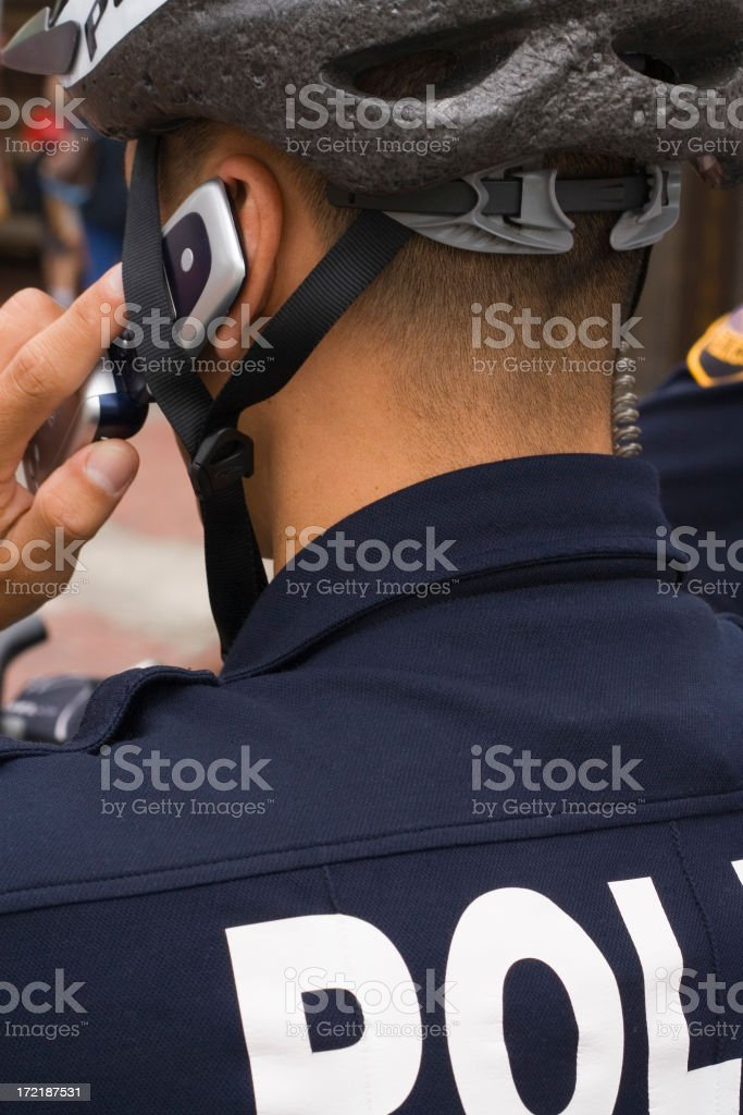 cop and cell phone stock photo