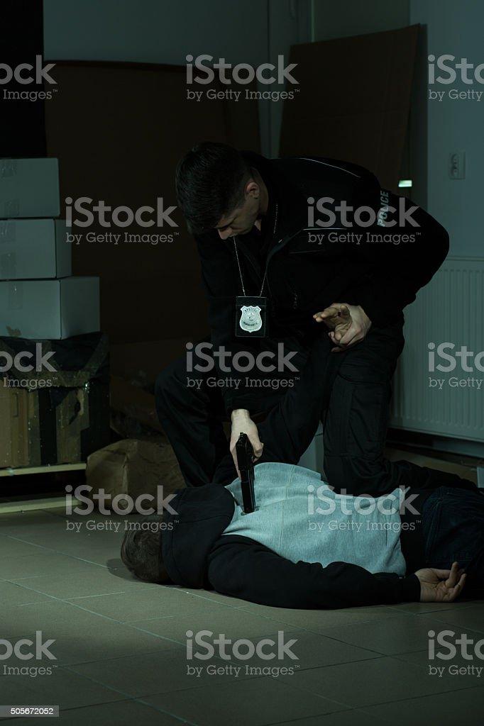 Cop overpowering a lawbreaker stock photo