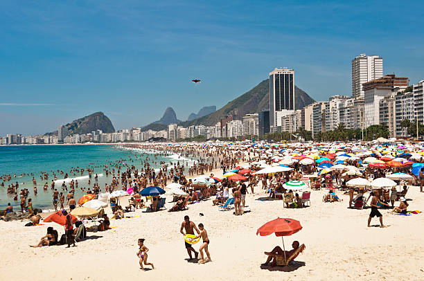 Copacabana Beach, Rio de Janeiro Rio de Janeiro, Brazil - December 28, 2014: Thousands of brazilians enjoy hot and sunny weekend in Copacabana beach. lagoa rio de janeiro stock pictures, royalty-free photos & images
