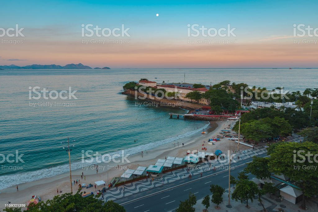 Copacabana Fort in Rio de Janeiro Copacabana Fort at the End of the Beach Aerial View by Sunset. Aerial View Stock Photo