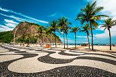 istock Copacabana Sidewalk Mosaic and Palm Trees in Rio de Janeiro 1250523627