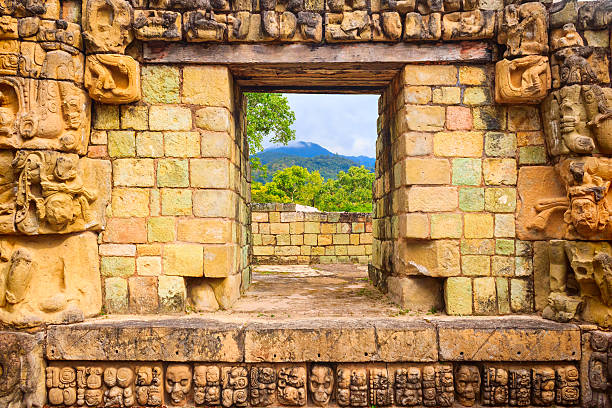 Copan Honduras Ornate Ancient Architecture Photo of an ancient ornate doorway in Copan, Honduras. Copan is an ancient Mayan site located in western Honduras, Central America. honduras stock pictures, royalty-free photos & images