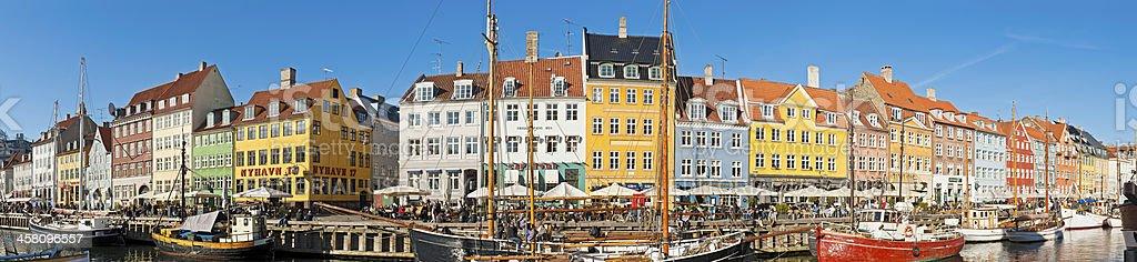 Copenhagen crowded harbour promenade panorama Nyhavn Denmark royalty-free stock photo