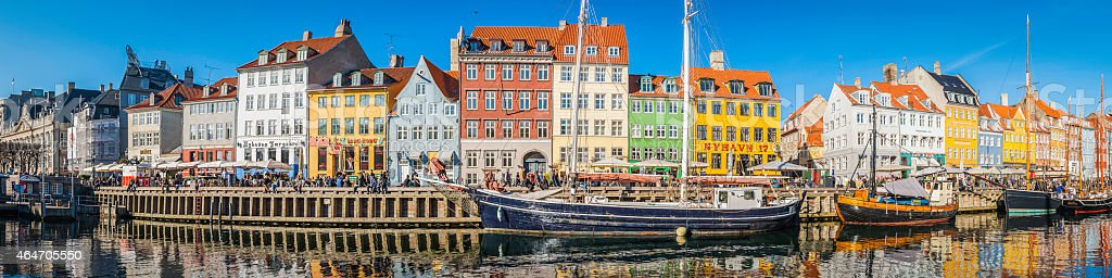 Copenhagen crowded Nyhavn colorful bars restaurants panorama beside harbour Denmark stock photo