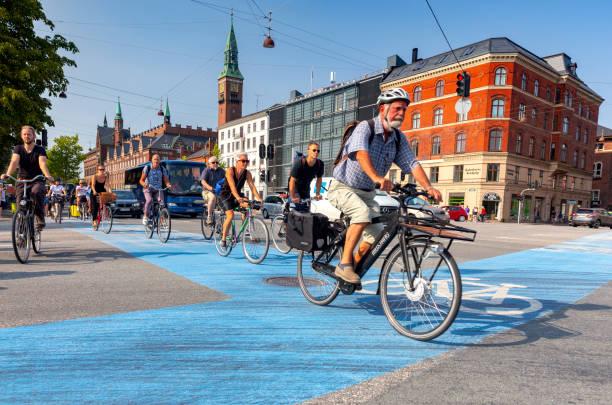 Copenhagen. Cyclists on a city street. stock photo