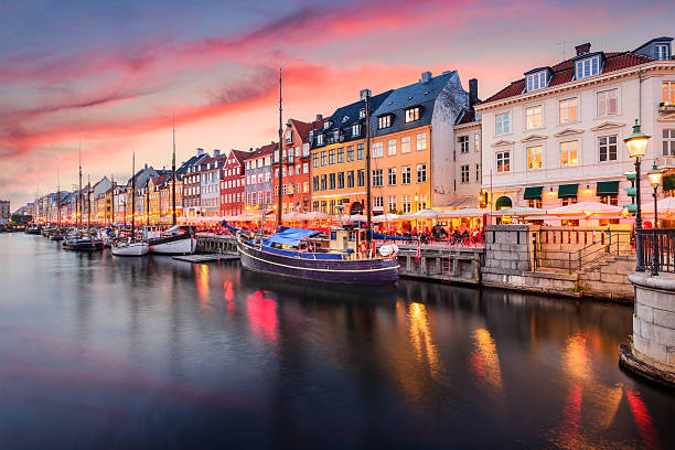 copenhagen, denmark at nyhavn canal - denmark stock photos and pictures