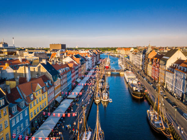 copenhagen, denmark. new harbour canal and entertainment famouse street. aerial shoot view from the top. - denmark stock photos and pictures