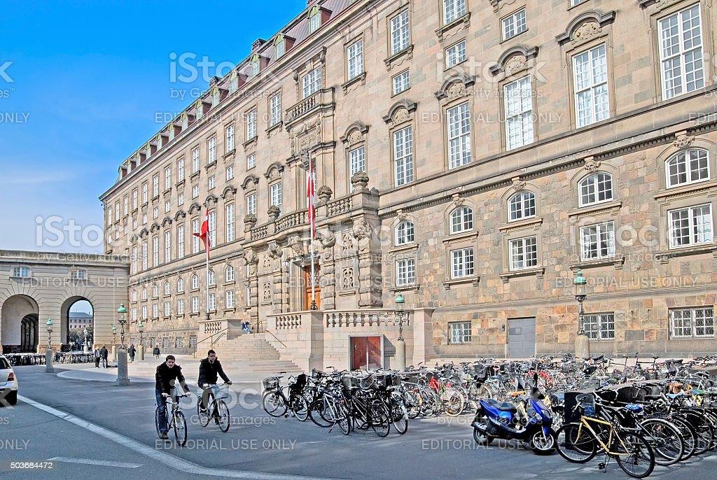 Copenhagen. Denmark. People on bicycles near The Danish Parliament stock photo