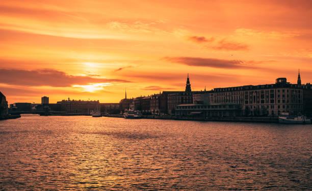 Copenhagen, Denmark Sunset over Water Showing Street stock photo