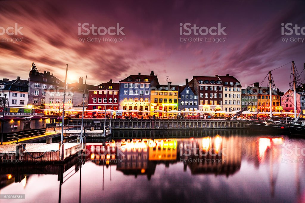 Copenhagen famous canal with boats and typical architecture stock photo