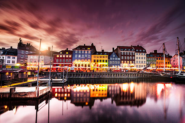 copenhagen famous canal with boats and typical architecture - denmark stock photos and pictures