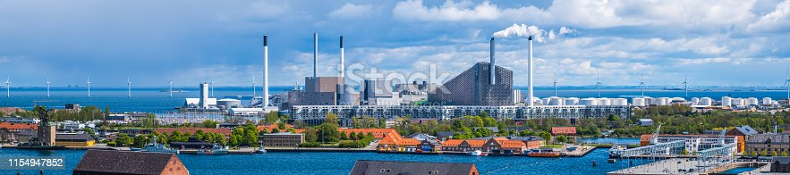 Aerial panoramic view over the rooftops of central Copenhagen to Refutaleoen, Amagerværket and the offshore wind farms beyond, Denmark.