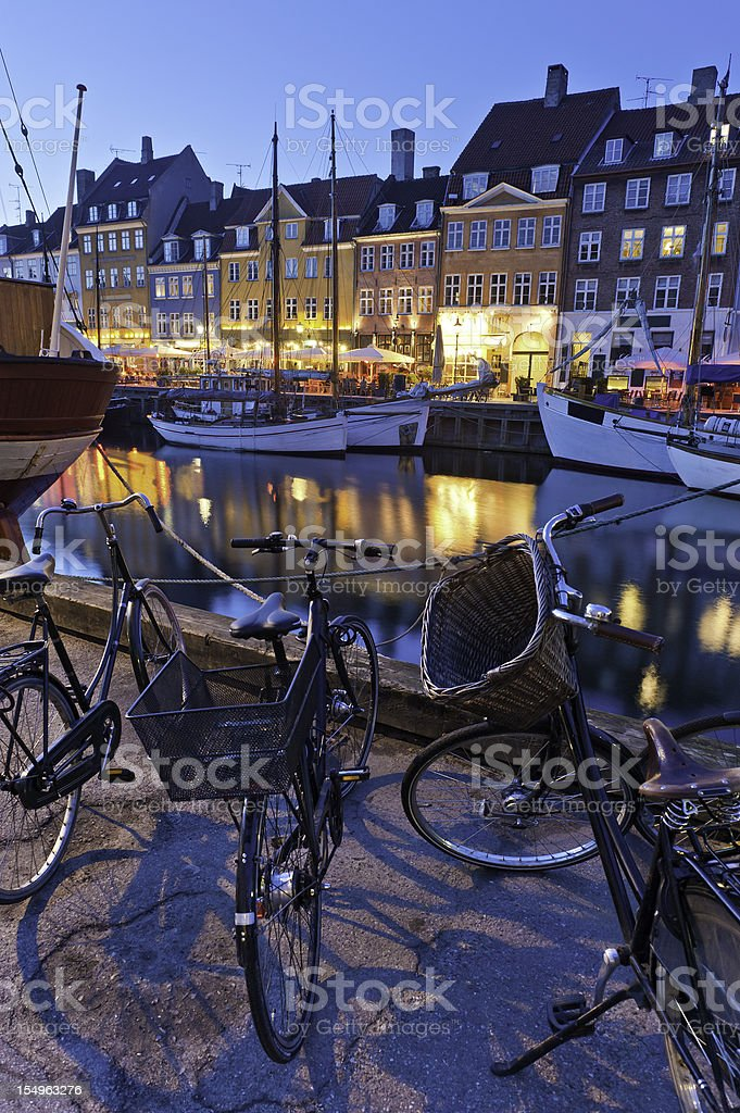 Copenhagen Nyhavn neon lights bicycles boats stock photo