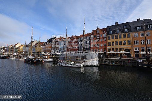 Copenhagen Nyhavn old harbour canal street view, Denmark. It's very famous and old historical district so lots of tourists visit this area every year. Good bars, restaurants and shops are located here.