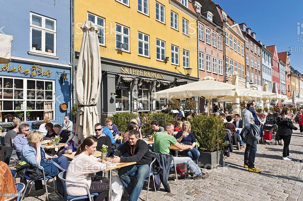 Copenhagen people relaxing at cafés Nyhavn Denmark royalty-free stock photo