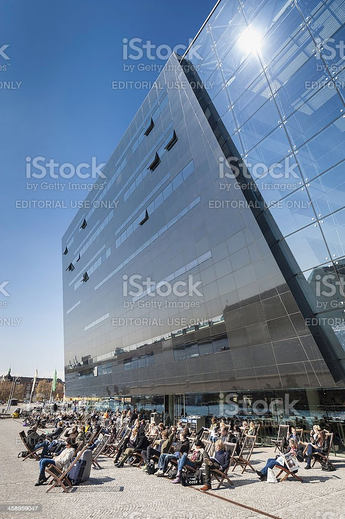 Copenhagen people sunbathing outside Black Diamond Library stock photo