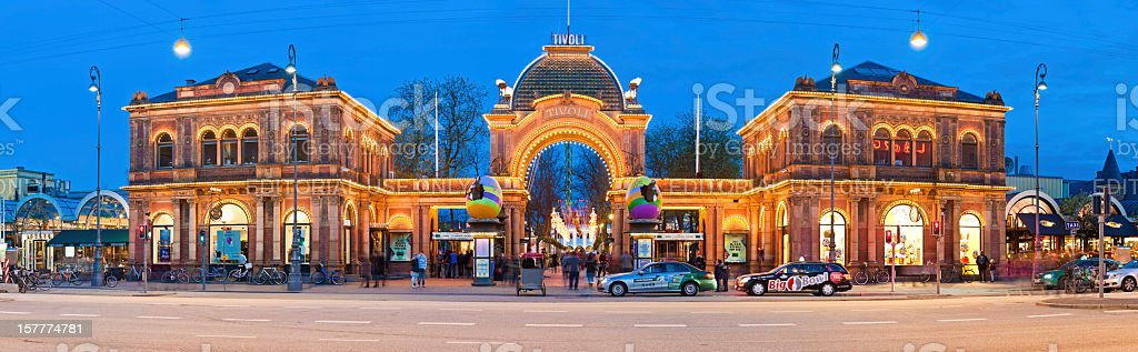 Copenhagen Tivoli Gardens amusement park illuminated entrance gate panorama Denmark stock photo