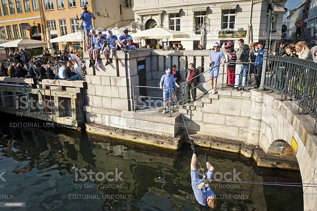 Copenhagen young men celebrating on waterfront stock photo
